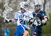 The Duke University men's lacrosse team outscored visiting Georgetown 9-3 in the second half to post a 14-12 come-from-behind victory over the Hoyas in men's lacrosse action this afternoon at Koskinen Stadium. Freshman attackman Jordan Wolf led the No. 4 Blue Devils with a career-high seven points from four goals and three assists.