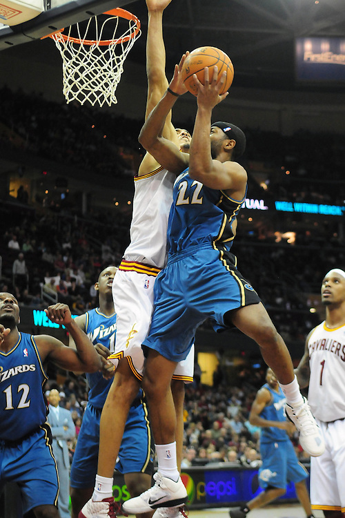April 13, 2011; Cleveland, OH, USA; Washington Wizards point guard Mustafa Shakur (22) shoots over Cleveland Cavaliers center Ryan Hollins (5) during the fourth quarter at Quicken Loans Arena. The Cavaliers beat the Wizards 100-93. Mandatory Credit: Jason Miller-US PRESSWIRE