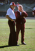 PALO ALTO, CA -  NOVEBMBER 9:  Jack Christiansen, Head Coach of Stanford University is seen with John Robinson, Head Coach of USC on the field prior to an NCAA football game between Stanford and USC played on November 9, 1974 at Stanford Stadium in Palo Alto, California.