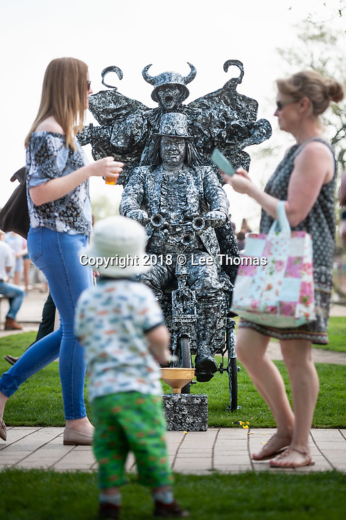 Bancroft Gardens, Stratford-Upon-Avon, Warwickshire, UK. 21st  April 2018.  The UK's first National Living Statue Championship attracts artists worldwide and thousands of visitors. Stratford-upon-Avon plays host to the UK's first National Living Statue Championship on 20-22 April as part of the annual Shakespeare's birthday celebrations in the Warwickshire town. A brand-new highlight of the extended three-day extravaganza, the Championship provides an opportunity for professional and junior Living Statues to pitch against the competition to win a cash prize. The competition runs on Saturday 21 April and Sunday 22 April in Bancroft Gardens and has two categories – professional (first prize £5000) and junior (first prize £50). Professionals will need to complete at least five 45-minute performances over the weekend, with juniors carrying out four 30-minute performances during the Championship. Pictured:  Bikeman from Czech Republic. // Lee Thomas, Tel. 07784142973. Email: leepthomas@gmail.com  www.leept.co.uk (0000635435)