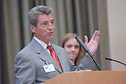 18174Sales Celebration and Awards Ceremony, April 19, 2007. Walter Hall Rotunda...Tom Starr presents the Starr Award to Erin Cochran