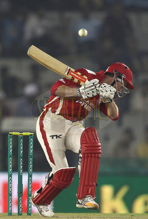 Kings XI Punjab captain George Bailey ducks under a short delivery during match 2 of the Oppo Champions League Twenty20 between the Kings XI Punjab and the Hobart Hurricanes held at the Punjab Cricket Association Stadium, Mohali, India on the 18th September 2014<br /> <br /> Photo by:  Shaun Roy / Sportzpics/ CLT20<br /> <br /> <br /> Image use is subject to the terms and conditions as laid out by the BCCI/ CLT20.  The terms and conditions can be downloaded here:<br /> <br /> http://sportzpics.photoshelter.com/gallery/CLT20-Image-Terms-and-Conditions-2014/G0000IfNJn535VPU/C0000QhhKadWcjYs