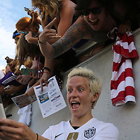 ORLANDO, FL - OCTOBER 25: Megan Rapinoe #15 of USWNT takes a funny selfie photo with fans after a women's international friendly soccer match between Brazil and the United States at the Orlando Citrus Bowl on October 25, 2015 in Orlando, Florida. The United States won the match 3-1. (Photo by Alex Menendez/Getty Images) *** Local Caption *** Megan Rapinoe