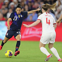 United States forward Christen Press (23) shoots the ball in front of England midfielder Keira Walsh (4) during the first match of the 2020 She Believes Cup soccer tournament at Exploria Stadium on 5 March 2020 in Orlando, Florida USA.