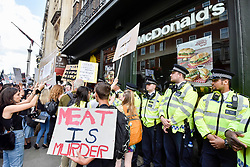 © Licensed to London News Pictures. 02/09/2017. London, UK.  Vegans and other demonstrators take part in an Animal Rights marching past a McDonald's en route to Parliament Square demanding an end to animal oppression in order to help the planet.  Photo credit : Stephen Chung/LNP