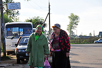 """Women head toward the market after coming into town on the bus in Uglich, Russia. As one of Russia's """"Golden Ring"""" cities, Uglich is designated a town of significant cultural and historic importance."""