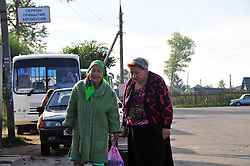 "Women head toward the market after coming into town on the bus in Uglich, Russia. As one of Russia's ""Golden Ring"" cities, Uglich is designated a town of significant cultural and historic importance."