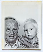 grandfather with a little child in a photo booth style image