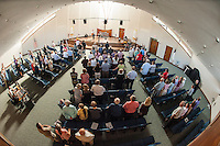 "Pastor Dan Lyle joins parishoners and guests in an opening song ""10,000 Reasons"" to begin the Evangelical Baptist Church dedication ceremony Sunday afternoon.  (Karen Bobotas/for the Laconia Daily Sun)"