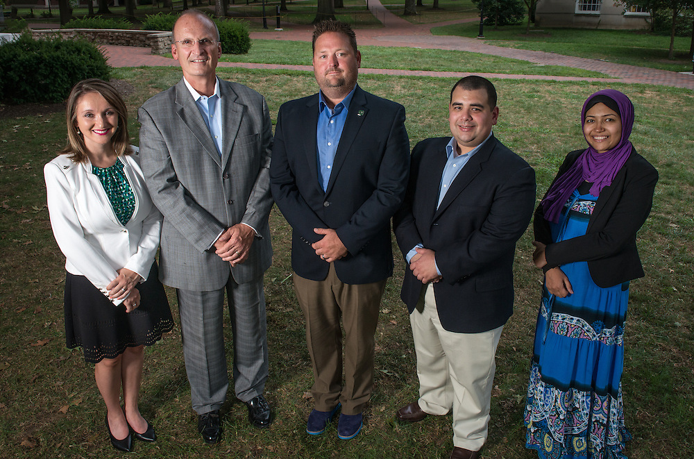 From left, Faculty members Alexa Fox, Dan Dahlen, Luke Sayers, Jacob Hiler, and Nirmin Maaruf, of Ohio University's College of Business pose on the College Green on August 24, 2016.