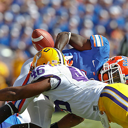 October 8, 2011; Baton Rouge, LA, USA;  Florida Gators running back Chris Rainey (1) fumbles after being hit by LSU Tigers linebacker Kevin Minter (46)during the first quarter at Tiger Stadium.  Mandatory Credit: Derick E. Hingle-US PRESSWIRE / © Derick E. Hingle 2011
