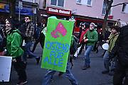 Frankfurt am Main | 18 Mar 2015<br /> <br /> Blockupy-Proteste in Frankfurt am 18.03.2015, hier: Demonstranten mit einem kleinen Schild mit der Aufschrift &quot;Ostend f&uuml;r Alle&quot;, die neue EZB steht im Frankfurter Ostend.<br /> <br /> photo &copy; peter-juelich.com