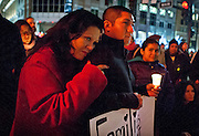 A. Cervantes, left, holds her husband, Armando Ramirez, close during the Keeping Families Together Candlelight Vigil held near Temple Square. The event, put on by the Salt Lake Dream Team, sought to remember families separated by immigration raids, deportations and a flawed immigration system, Wednesday, Dec. 12, 2012.