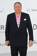ANTIBES, FRANCE - MAY 24:  Jean Pigozzi arrives at amfAR's Cinema Against AIDS at Hotel Du Cap on May 24, 2012 in Antibes, France.  (Photo by Tony Barson/FilmMagic)