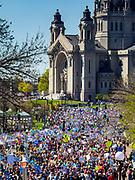 22 APRIL 2017 - ST. PAUL, MN: Marchers make their way to the Minnesota State Capitol during the March for Science. The St. Paul Cathedral is in the background. More than 10,000 people marched from the St. Paul Cathedral to the Minnesota State Capitol in St. Paul during the March for Science. March organizers said the march was non-partisan and was to show support for the sciences, including the sciences behind climate change and vaccines.      PHOTO BY JACK KURTZ