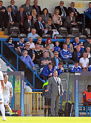 Peterborough United Manager, Darren Ferguson on the touchline while his father Sir Alex Ferguson sits in the stands - Photo mandatory by-line: Joe Dent/JMP - Mobile: 07966 386802 09/08/2014 - SPORT - FOOTBALL - Rochdale - Spotland Stadium - Rochdale AFC v Peterborough United - Sky Bet League One - First game of the season