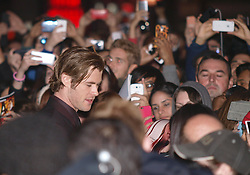 Actor Chris Hemsworth, left, surrounded by his fans as he arrives for the World Premiere of his latest film Thor The Dark World.  in London's Leicester Square, England, United Kingdom. Tuesday, 22nd October 2013. Picture by Max Nash / i-Images