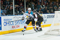 KELOWNA, CANADA - MARCH 21: Dakota Odgers #36 of Vancouver Giants checks Joe Gatenby #28 of Kelowna Rockets on March 21, 2015 at Prospera Place in Kelowna, British Columbia, Canada.  (Photo by Marissa Baecker/Shoot the Breeze)  *** Local Caption *** Joe Gatenby; Dakota Odgers;