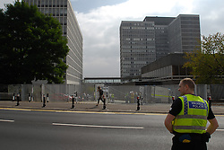 © Licensed to London News Pictures. 11/09/2014. Llanishen, Cardiff, UK.  A 'suspicious package' was found this morning at the HMRC offices in Llanishen in Cardiff, emergency services called and the buildings evacuated at around 10am. Surrounding roads were shut off. Royal Logistic Corps Bomb disposal team was called in and two controlled explosions carried out at around 13:30. The packabge was found to be harmless - a bundle of dense paper and an electrical device according to Police.  Photo credit : Ian Homer/LNP
