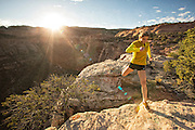 Pro climber Mayan Smith-Gobat trail running in Colorado National Monument near Grand Juction Colorado.