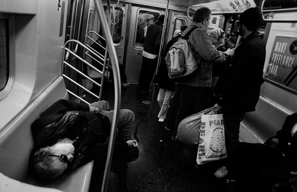 "Man passed out on the L Train to Brooklyn and Williamsburg...Part of long-term (2005-2008) story ""I See A Darkness"". New York, NY."