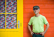 Katsutoshi Tomiyama stands outside one of the rainbow-colored cabins at his The Cicada Fort that stands on the tsunami-ravaged land where his home and business used to be in Takata district in Rikuzentakata, Iwate Prefecture Japan on 08 Oct. , 2013. PHOTO: ROB GILHOOLY