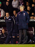 Photo. Jed Wee, Digitalsport<br /> Sheffield United v Arsenal, FA Cup 5th Round Replay, 01/03/2005.<br /> Arsenal's manager Arsene Wenger (R) with Sheffield United counterpart Neil Warnock.