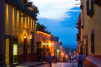 Street scene off  the main square (Plaza Principal) at twilight, San Miguel de Allende, Mexico