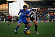 Notts County's Jorge Grant(10) and Stevenage midfielder Luke Amos (14) during the EFL Sky Bet League 2 match between Notts County and Stevenage at Meadow Lane, Nottingham, England on 24 February 2018. Picture by Nigel Cole.