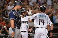 Sep 8, 2017; Phoenix, AZ, USA; Arizona Diamondbacks outfielder Reymond Fuentes (14) is congratulated by outfielder David Peralta (6) after hitting a two run home run in the fifth inning against the San Diego Padres at Chase Field. Mandatory Credit: Jennifer Stewart-USA TODAY Sports