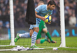 MANCHESTER, ENGLAND - Sunday, January 8, 2012: Manchester City's Sergio Aguero celebrates scoring the first goal against Manchester United during the FA Cup 3rd Round match at the City of Manchester Stadium. (Pic by Vegard Grott/Propaganda)
