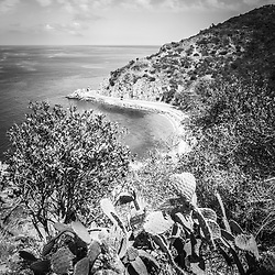Lover's Cove Catalina Island black and white aerial photo. Lovers Cove is a popular spot on Catalina Island for snorkeling and diving. Catalina Island is a popular travel destination off the coast of Southern California in the United States.