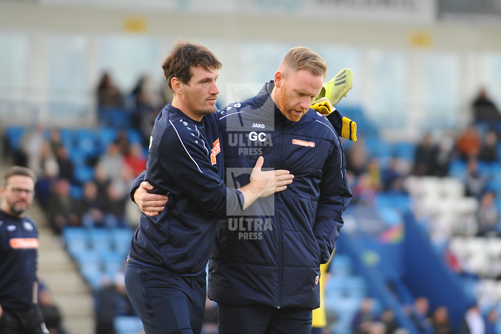 TELFORD COPYRIGHT MIKE SHERIDAN Gavin Cowan greets a member of Guiseley's coaching staff during the Vanarama National League Conference North fixture between AFC Telford United and Guiseley on Saturday, October 19, 2019.<br /> <br /> Picture credit: Mike Sheridan/Ultrapress<br /> <br /> MS201920-026