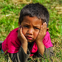 Young Nepalese boy posin for photograph