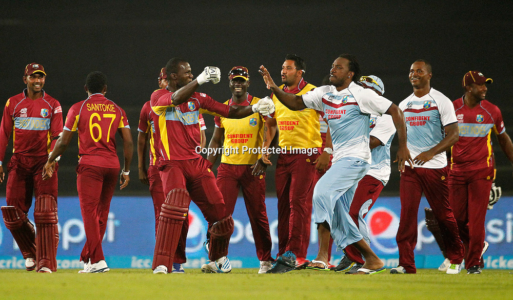 Chris Gayle celebrates with West Indies team after winning - West Indies v Australia, ICC World Twenty20, Bangladesh 2014. 28 March 2014, Sher-e-Bangla National Cricket Stadium, Mirpur. Photo: Shamsul hoque Tanku/www.photosport.co.nz