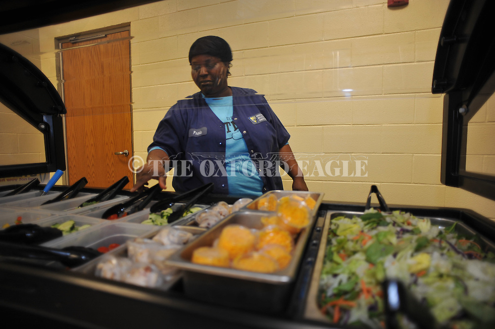 Freda Fondren sets up the salad bar in the Oxford High cafeteria, on Tuesday, April 1, 2014.