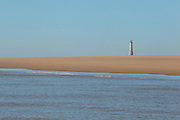 The Phare de Cordouan, or Cordouan Lighthouse, seen in the distance across a sand bank, built 1584-1611 in Renaissance style by Louis de Foix, 1530-1604, French architect, located 7km at sea, near the mouth of the Gironde estuary, Aquitaine, France. This is the oldest lighthouse in France. There are 4 storeys, with keeper apartments and an entrance hall, King's apartments, chapel, secondary lantern and the lantern at the top at 68m. Parabolic lamps and lenses were added in the 18th and 19th centuries. The lighthouse is listed as a historic monument. Picture by Manuel Cohen