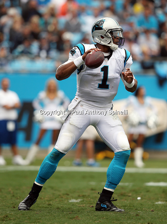 Carolina Panthers quarterback Cam Newton (1) drops back to pass during the 2015 NFL week 3 regular season football game against the New Orleans Saints on Sunday, Sept. 27, 2015 in Charlotte, N.C. The Panthers won the game 27-22. (©Paul Anthony Spinelli)