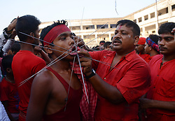 April 14, 2017 - Kolkata - Indian Hindu devotee pierced with iron rod during the Gajan festival in Burdwan district of West Bengal, India on Friday , 14th April , 2017.Gajan is a Hindu festival celebrated mostly in the Indian state of West Bengal. It is associated with such deities as Shiva, Neel and Dharmathakur. Gajan spans around a week, starting at the last week of Chaitro continuing till the end of the Bengali year. It ends with Charak Puja. Participants of this festival is known as Sannyasi or Bhokta. The central theme of this festival is deriving satisfaction through  devotion and sacrifice. (Credit Image: © Sonali Pal Chaudhury/NurPhoto via ZUMA Press)