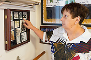 AUG. 11, 2012 - MERRICK, NEW YORK, U.S. - BARBARA BYRNE points to a photo of herself taken when she was a WAC (U.S. Women's Army Corps) in the 1960s. The photo was on display at the American Legion Post 1282 headquarters during the barbecue the post hosted there for vets from Long Island State Veterans Home at Stony Brook University. Byrne is a dual member of both the Merrick Post and Auxiliary Unit.