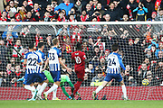 Brighton and Hove Albion goalkeeper Matthew Ryan (1) is beaten by Liverpool defender Virgil van Dijk (4) for the first goal 1-0 during the Premier League match between Liverpool and Brighton and Hove Albion at Anfield, Liverpool, England on 30 November 2019.