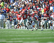 Ole Miss' Nickolas Brassell (2) runs against Arkansas linebacker Alonzo Highsmith (45) and Arkansas cornerback Isaac Madison (6) at Vaught-Hemingway Stadium in Oxford, Miss. on Saturday, October 22, 2011. .