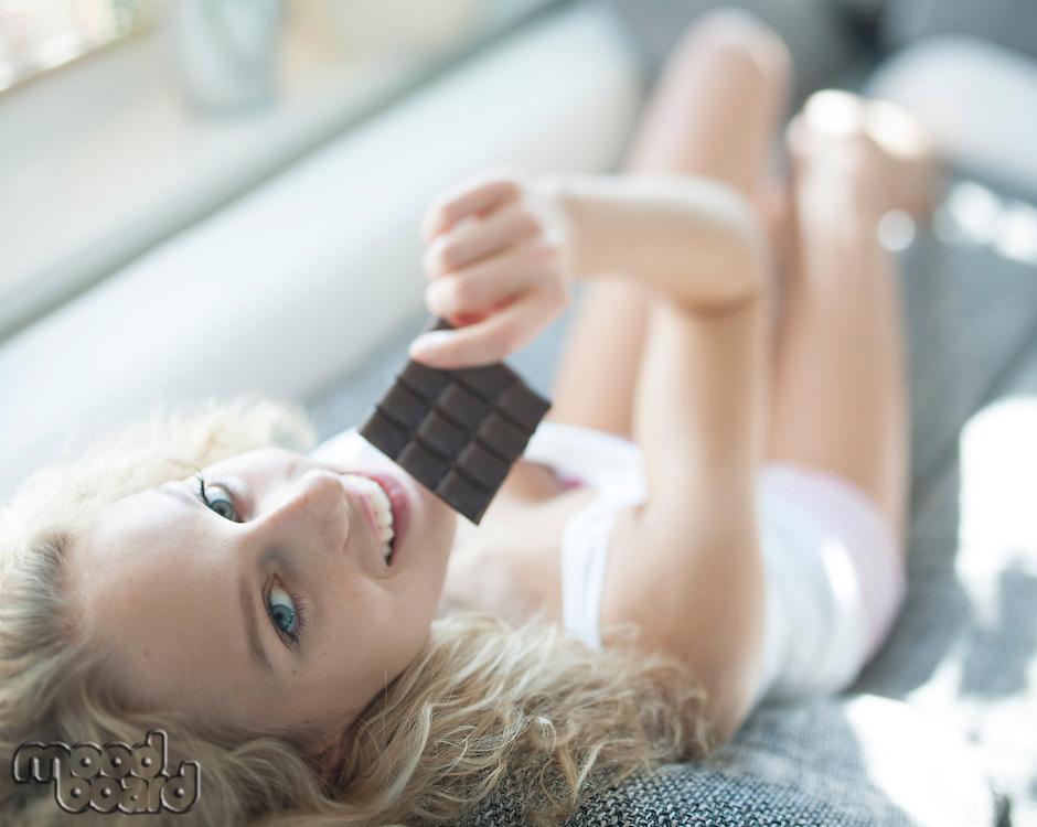 High angle portrait of woman having chocolate bar