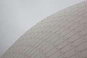 "The roof is constructed of a series of precast concrete ""shells"". The roofs of the Sydney Opera House are covered in a subtle chevron pattern with 1,056,006 glossy white- and matte-cream-colored Swedish-made glazed ceramic  tiles from Höganäs AB though, from a distance, the shells appear a uniform white...Architect: Jørn Utzon. Structural engineer: Ove Arup & Partners. Completed: 1973. UNESCO World Heritage Site 2007"