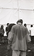 Man with sweat patches on his top at the first outdoor rave up North, The Gio Goi Joy Rave run by Anthony and Chris Donnelly, Ashworth Valley, Rochdale, 5th August 1989.