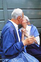 elderly couple, kissing