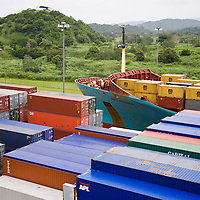 Cargo ships crossing the Panama Canal at Miraflores Locks, Panama City, Central America