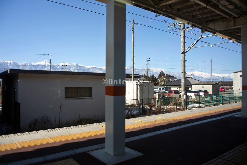 the Japanese Alps seen from train station on the  Shinonoi line