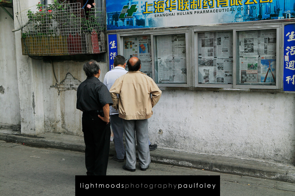 Reading newspaper in Old Shanghai, China