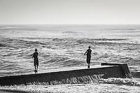 Surf anglers at Umkomazi river mouth. Aliwal Shoal Marine Protected Area. Southern KwaZulu Natal. South Africa